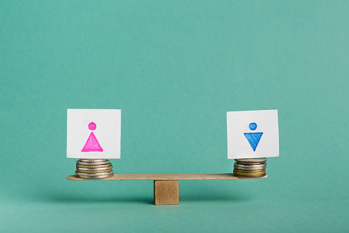 istock Equal Pay for man and woman concept 1135348937
