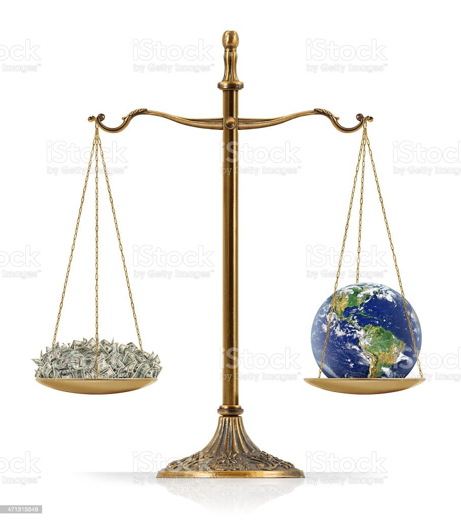"""Equal Weighted: Money and Earth There is money at the one side of """"Scales of Justice"""" while there is world globe on the other side. In this version, money and world globe are equal weighted. Isolated on white background. American One Hundred Dollar Bill Stock Photo"""