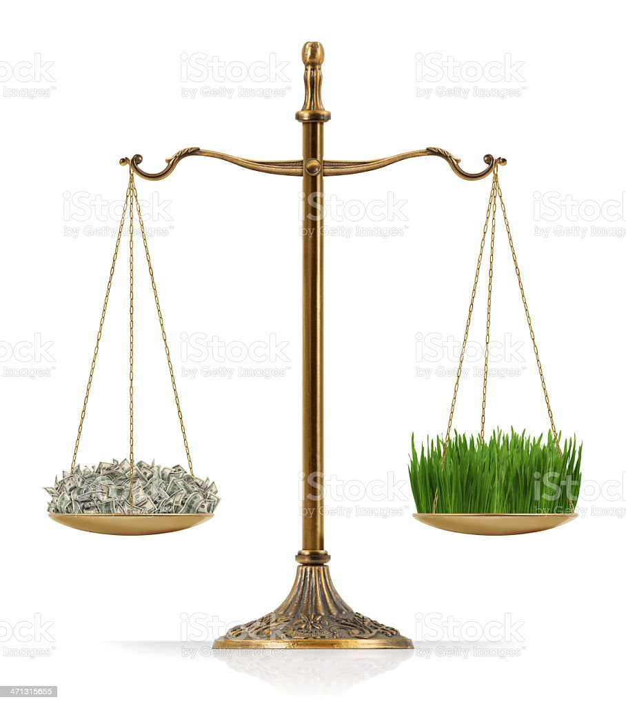 "Equal Weighted: Money and Grass There is money at the one side of ""Scales of Justice"" while there is grass on the other side. In this version, money and grass are equal weighted. Isolated on white background. Agricultural Field Stock Photo"
