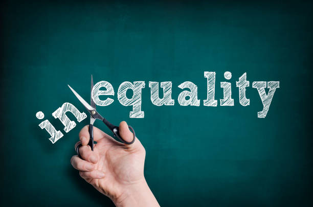 Equality The male hand with scissors cuts word Equality from Inequality unbalanced stock pictures, royalty-free photos & images