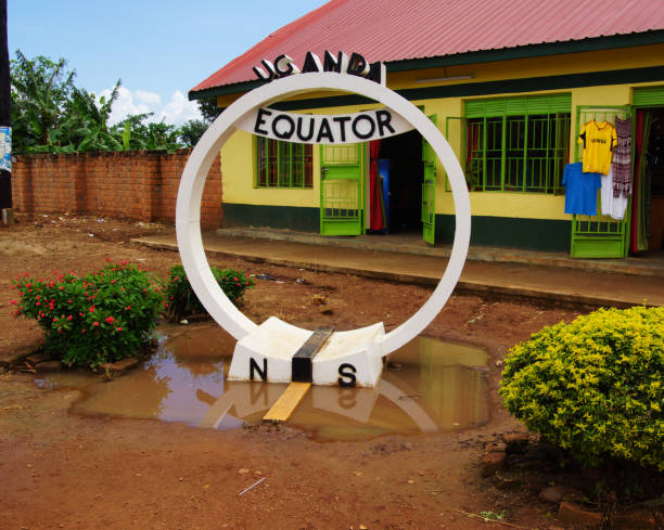 equator in Uganda a point in Uganda, which shows the course of the equator equator stock pictures, royalty-free photos & images