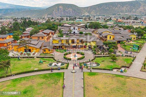 Aerial view from Equatorial line monument and the Andes mountains in Quito with tourists walking on the site, Ecuador.