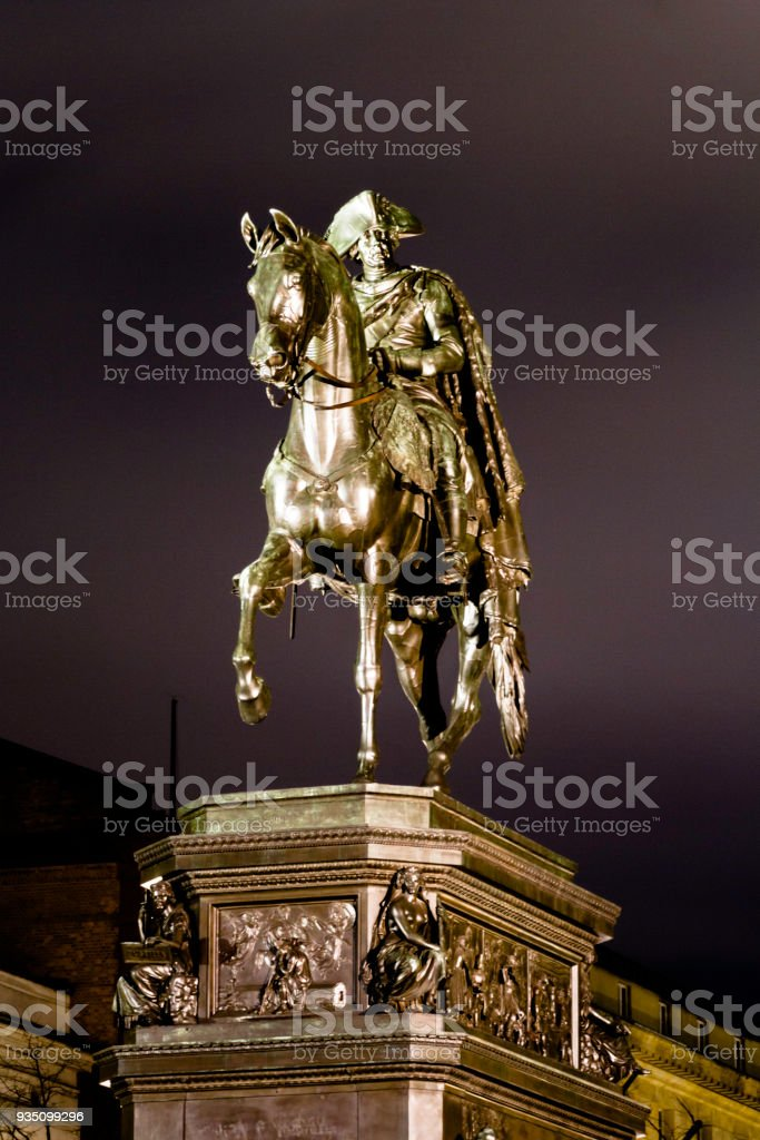 Equestrian statue of Frederick the Great in the evening illumination. Outdoor sculpture in cast bronze at the east end of Unter den Linden in Berlin, honouring King Frederick II of Prussia. stock photo