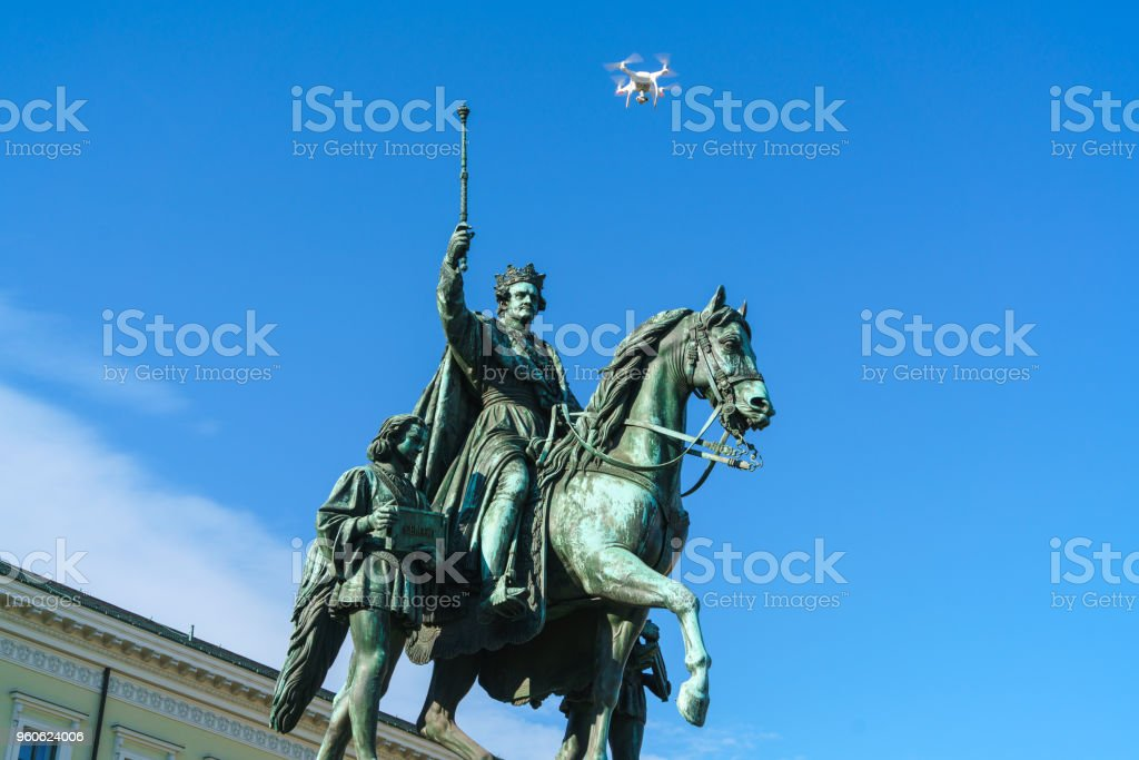 Equestrian statue of Ludwig I of Bavaria (1862) and flying drone quadrocopter, Munich, Germany stock photo