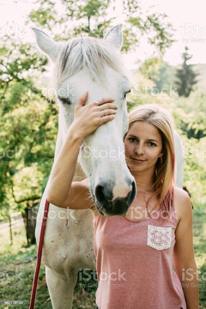 Equestrian, woman with horse - Foto stock royalty-free di Adulto