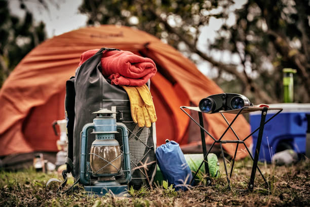 Equipment and accessories for mountain hiking in the wilderness stock photo