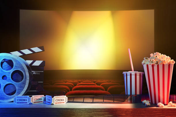 Equipment and elements of cinema with background cinema Equipment and elements of cinema on wooden table and background cinema. Concept of watching movies. Horizontal composition. Front view. movie theater stock pictures, royalty-free photos & images