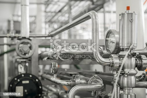 measurement sensors and pipes in the factory. equipment at the dairy plant