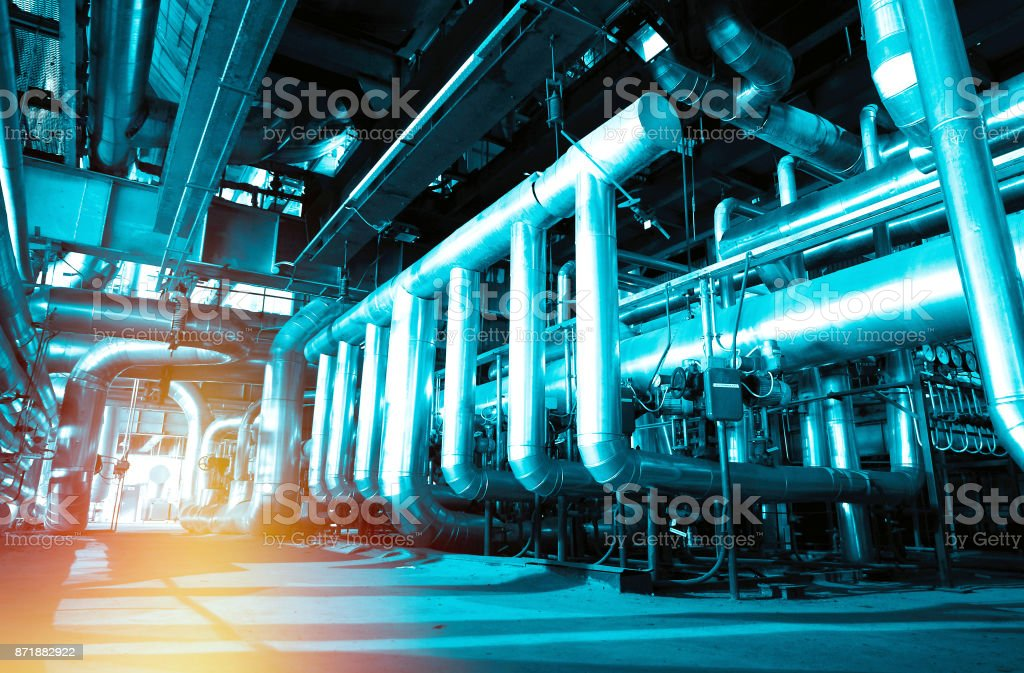 Equipment, cables and piping as found inside of a modern industrial power plant stock photo