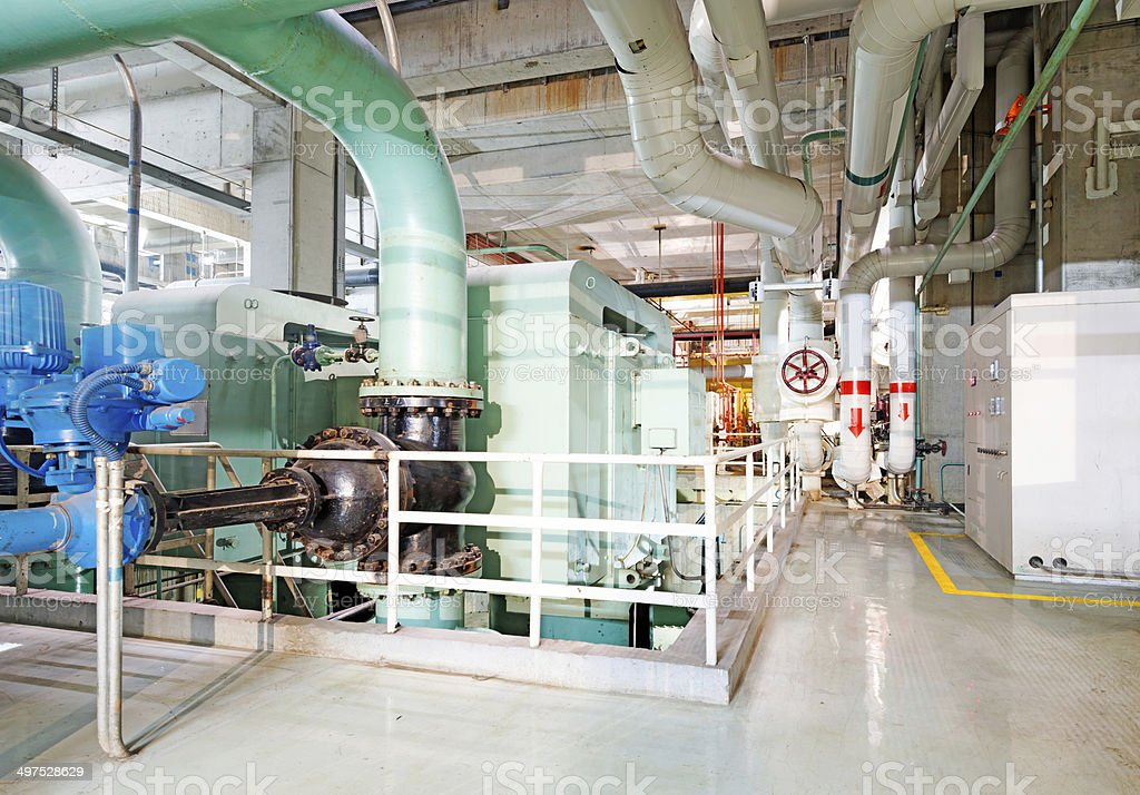 Equipment, cables and piping as found inside of industrial power royalty-free stock photo