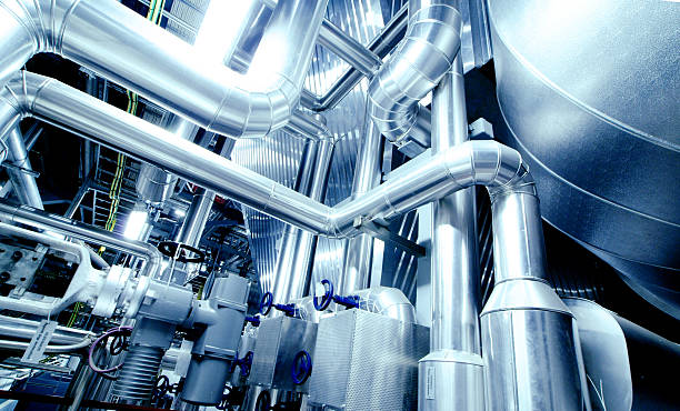 Equipment, cables and piping Equipment, cables and piping as found inside of a modern industrial power plant. chemical plant stock pictures, royalty-free photos & images