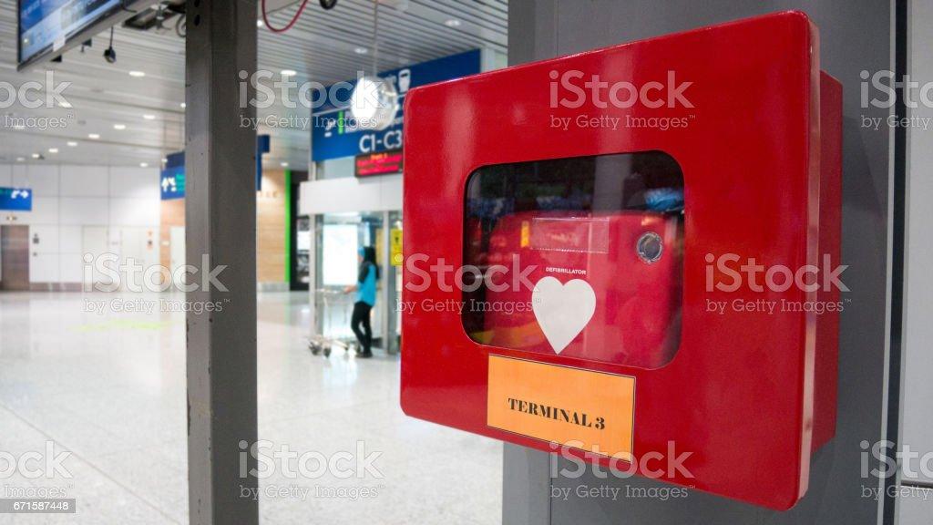 CPR equipment defibrillator install in public location in the departure airport. stock photo