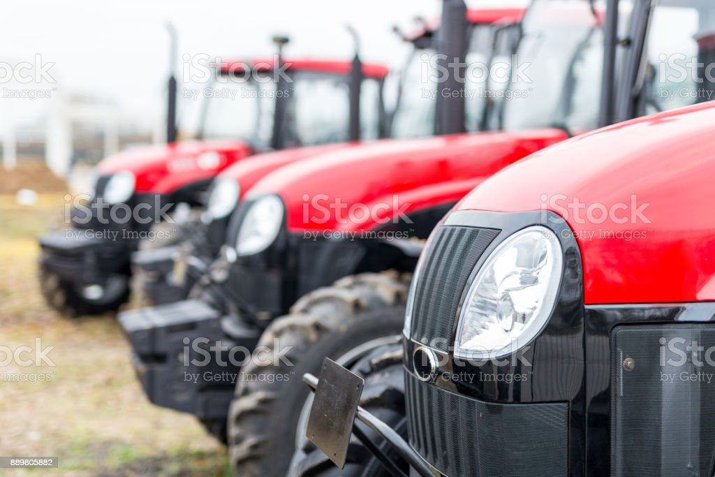 Equipment for agriculture, machines  presented to an agricultural exhibition.  Tractors outdoors stock photo