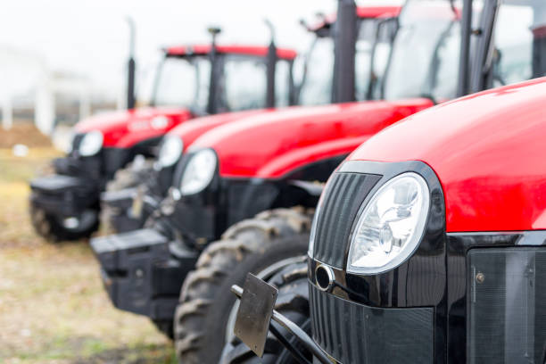 Equipment for agriculture, machines  presented to an agricultural exhibition.  Tractors outdoors Equipment for agriculture, machines  presented to an agricultural exhibition.  Tractors outdoors. agricultural equipment stock pictures, royalty-free photos & images