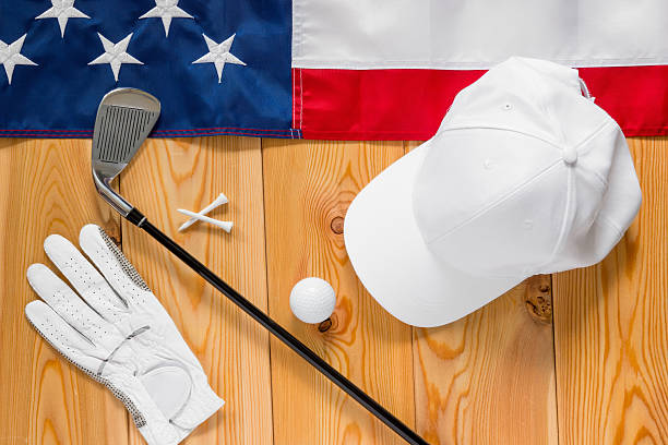 Equipment for golf and an American flag on  wooden floor stock photo