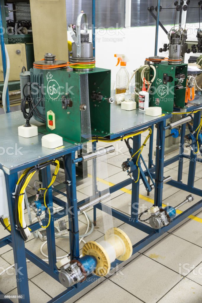 Equipment for manufacturing metal braids stock photo