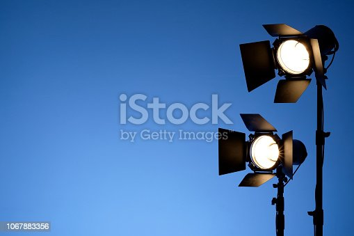 Equipment for photo studios and fashion photography. Blue copyspace, lens flare effect