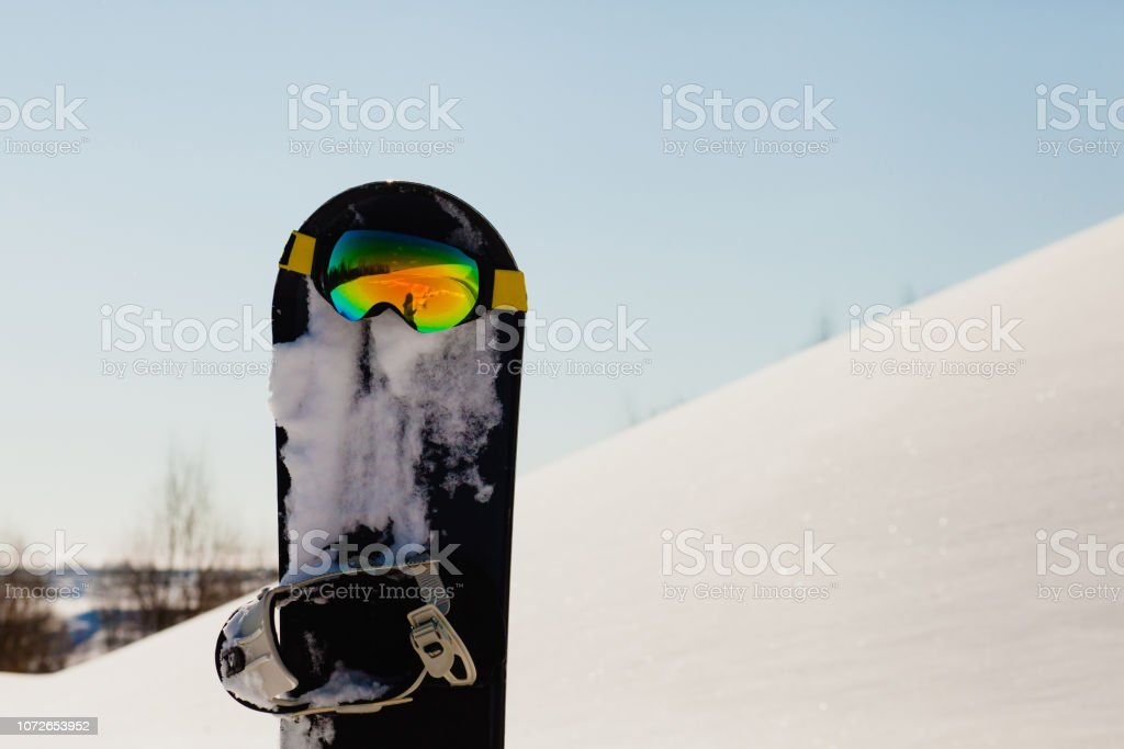 Equipment for snowboarding on the slope stock photo