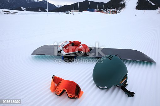 istock Equipment for snowboarding on track lines at ski slope left by a snowcat 928613950