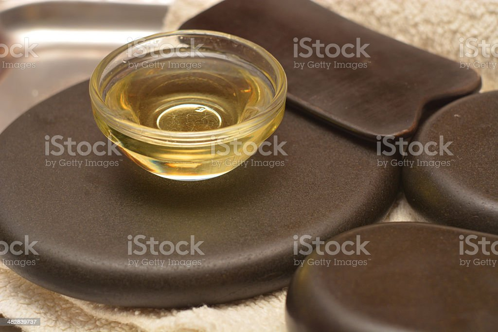 Equipment for stone therapy and massage gua sha stock photo