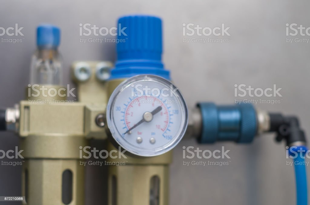 Equipment for washing compressed air, air gauge in the foreground. stock photo