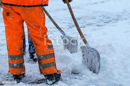 istock Equipment from worker who sweep snow 610691316