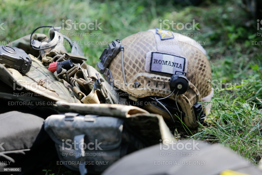 Equipment of Romanian military paratroopers lay on the ground before...