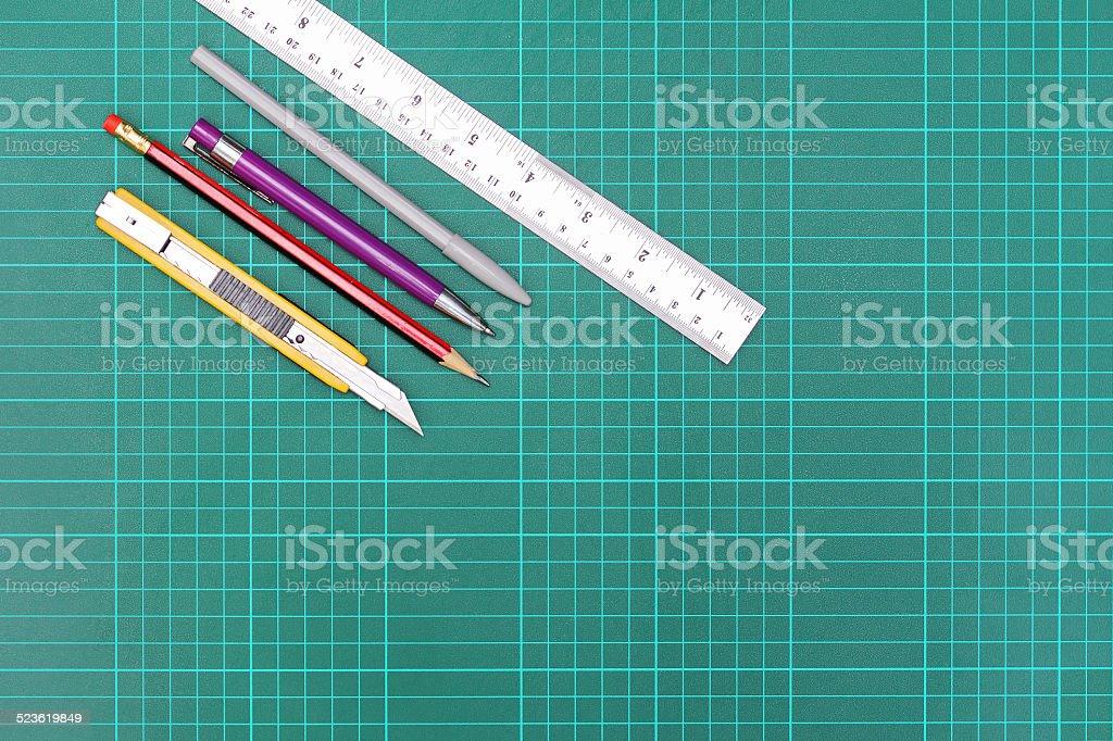 equipment on cutting mat stock photo