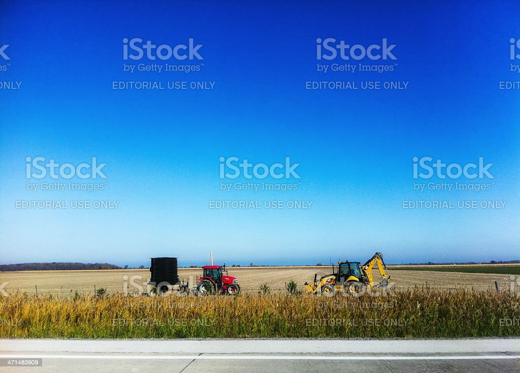 Equipment Used For Tiling Fields Sitting In A Field In Fall. Tile...