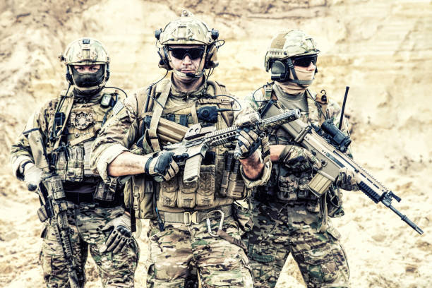 Equipped elite forces soldiers in combat readiness stock photo