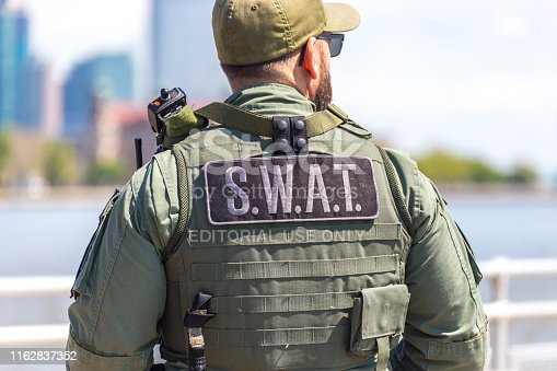 equipped swat soldier standing on a pier in New York