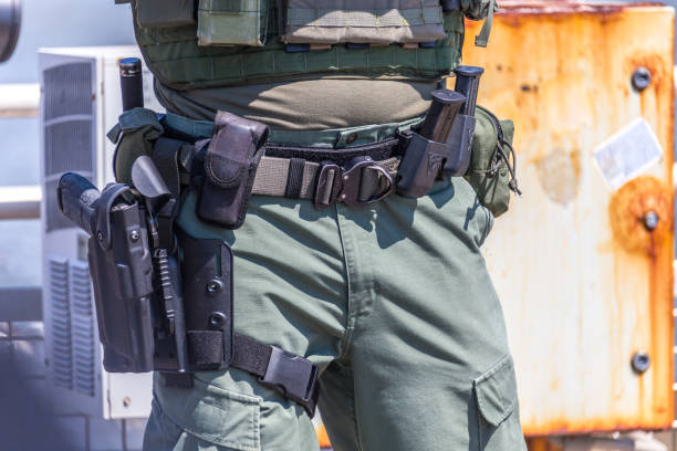 equipped swat soldier standing on a pier stock photo