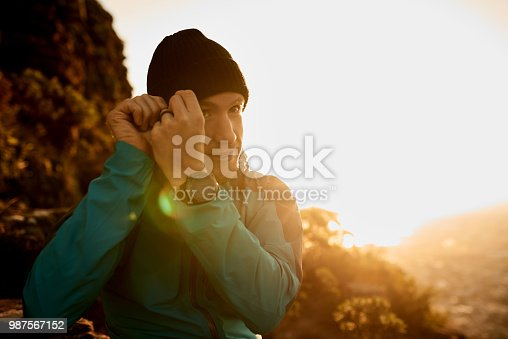 Cropped shot of a young man enjoying an early morning hike in the mountains