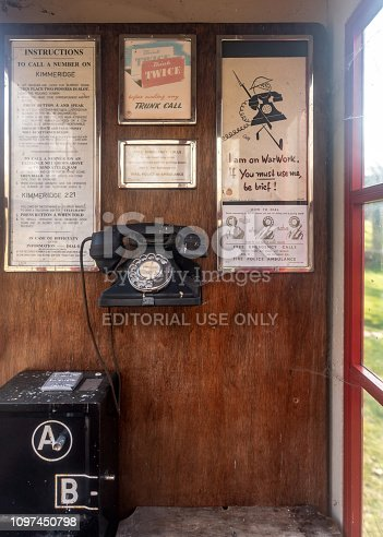 Wareham, UK. 20th January 2019. Inside a WWII era telephone box payphone with war posters