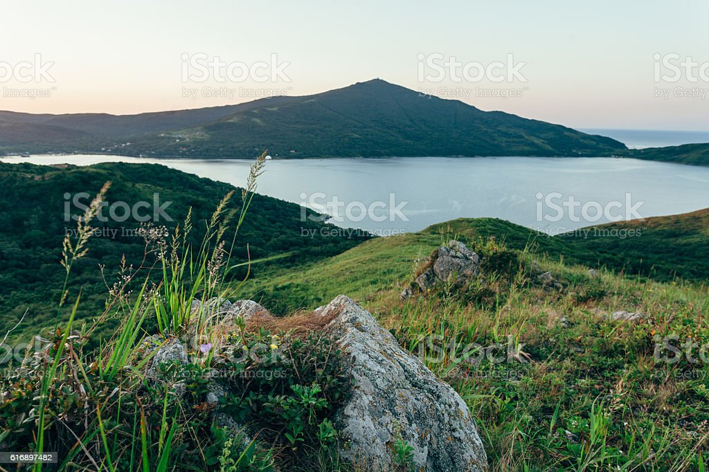 eraly sunrise over hills and sea bay stock photo