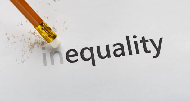 Erase part In in word Inequality on white background Equality concept. Erase part In in word Inequality with pencil eraser on white background, panorama human rights stock pictures, royalty-free photos & images