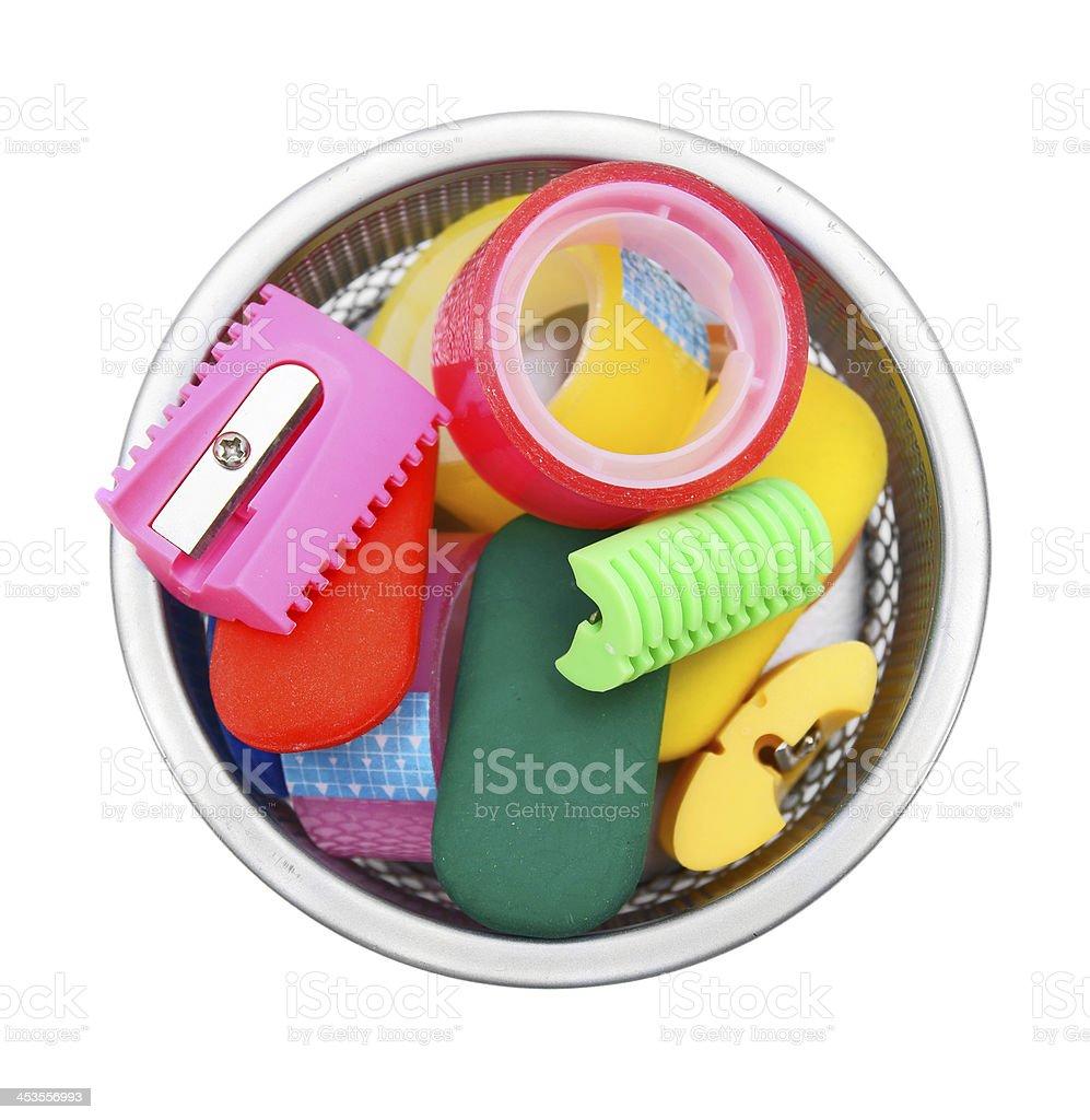 Eraser, adhesive tape, sharpener in basket. royalty-free stock photo
