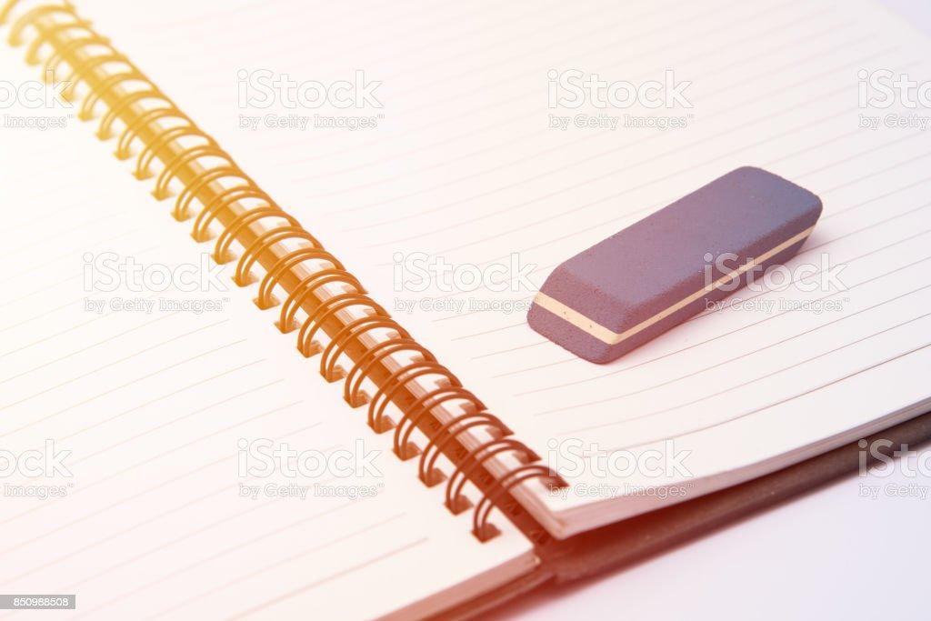 eraser on blank notebook stock photo