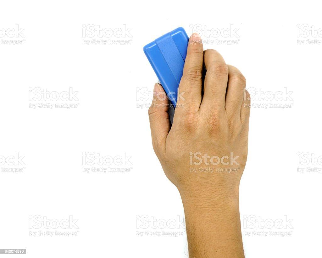 Hand holding brush erase isolated on white background