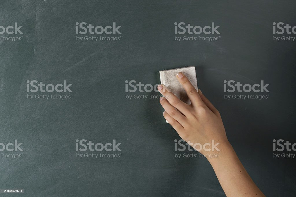 Erasing chalk stock photo