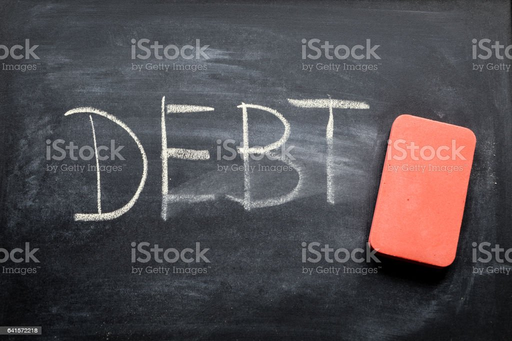 erasing debt, hand written word on blackboard being erased concept stock photo