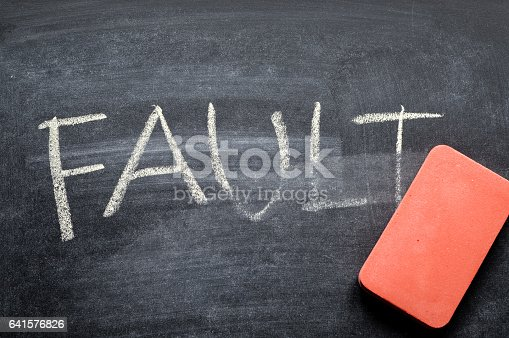 istock erasing fault, hand written word on blackboard being erased concept 641576826