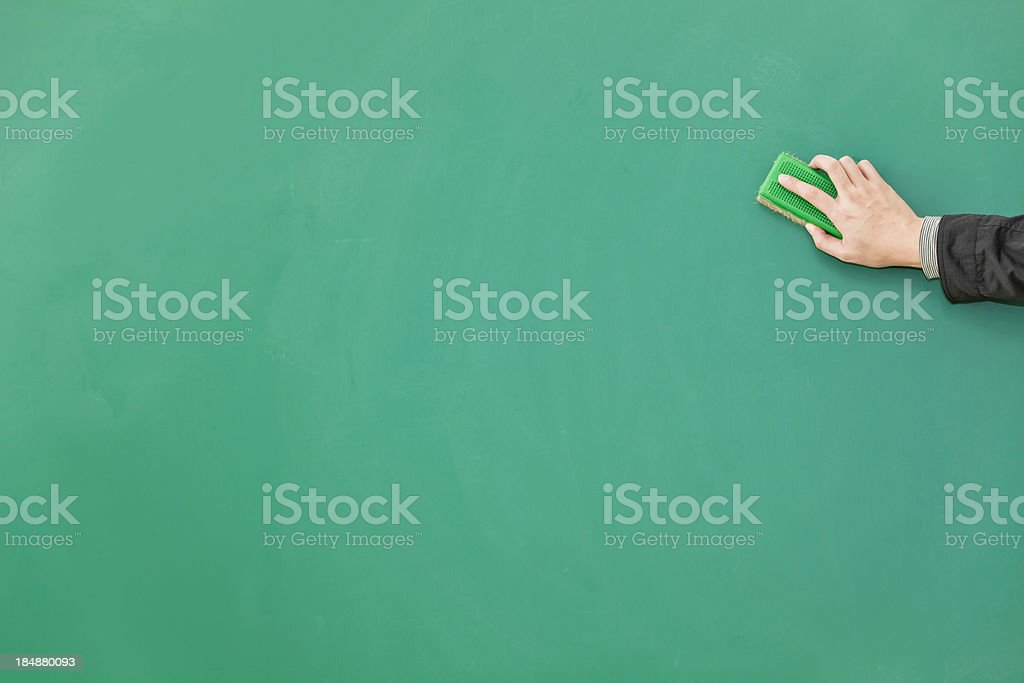 erasing green blackboard royalty-free stock photo