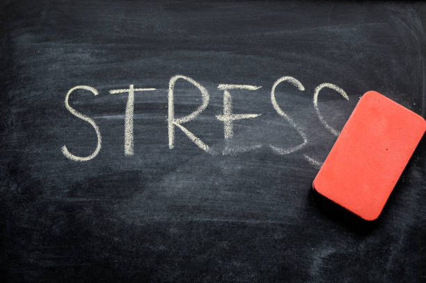 erasing stress, hand written word on blackboard being erased concept erasing stress, hand written word on blackboard being erased concept well structure stock pictures, royalty-free photos & images