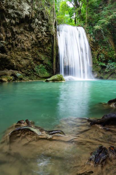 Erawan Falls (The third waterfall – Pha Nam Tok) with emerald green pond in Erawan  National Park. stock photo