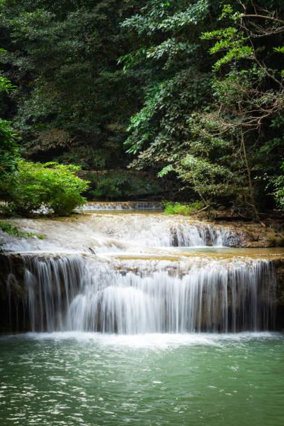 Erawan Falls with emerald green ponds in Erawan  National Park. stock photo