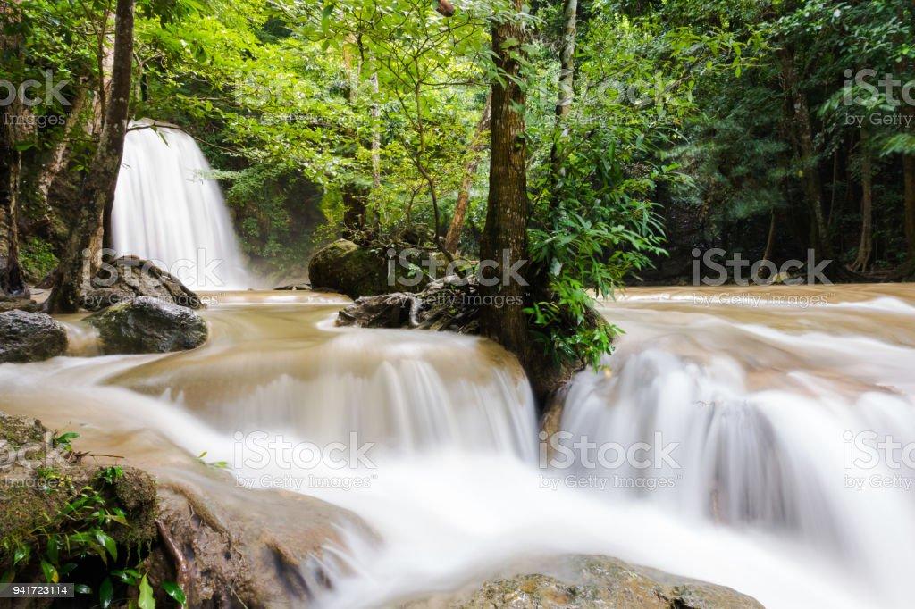 Erawan National Park beautiful waterfall in kanchanaburi Thailand after the rain storm.flash flood.turbid water. stock photo