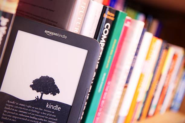 Ereader Amazon Kindle On A Bookshelf Stock Photo Download