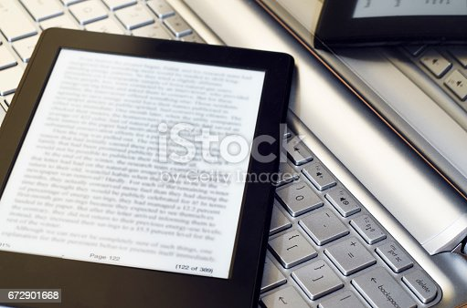 932821906 istock photo E-Reader Over Laptop 672901668