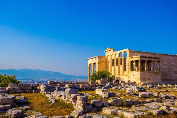Erechtheion temple in Athens during the sunset. Ruins of the Temple of Erechtheion and Temple of Athene at the Acropolis hill in Greece. stock photo